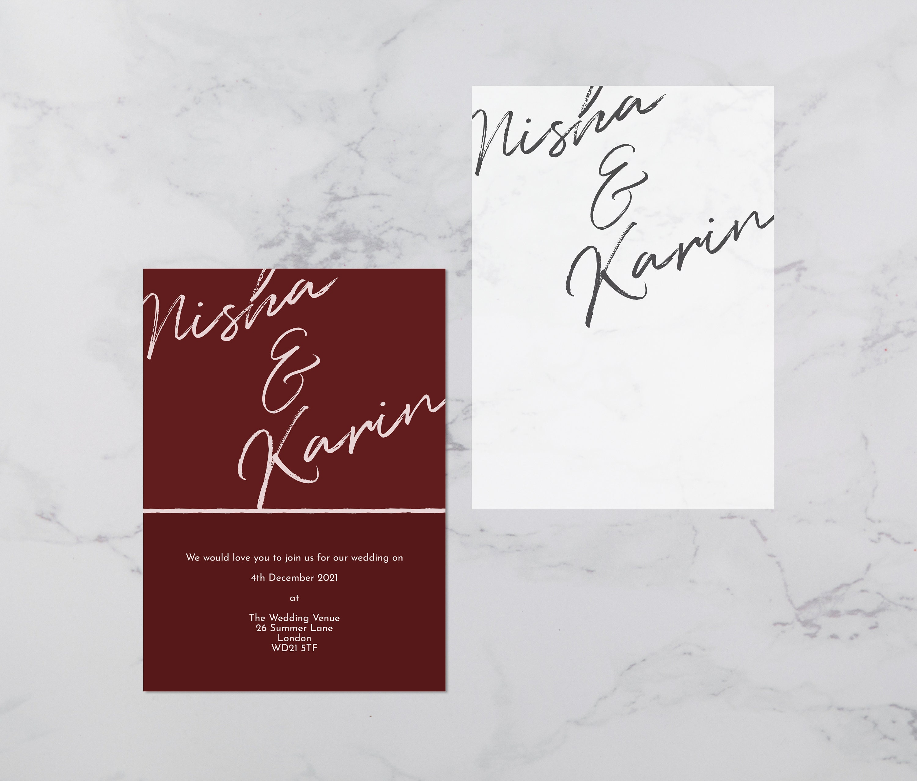 Flat lay photograph showing a burgundy wedding invitation and the vellum overlay sheet separately.