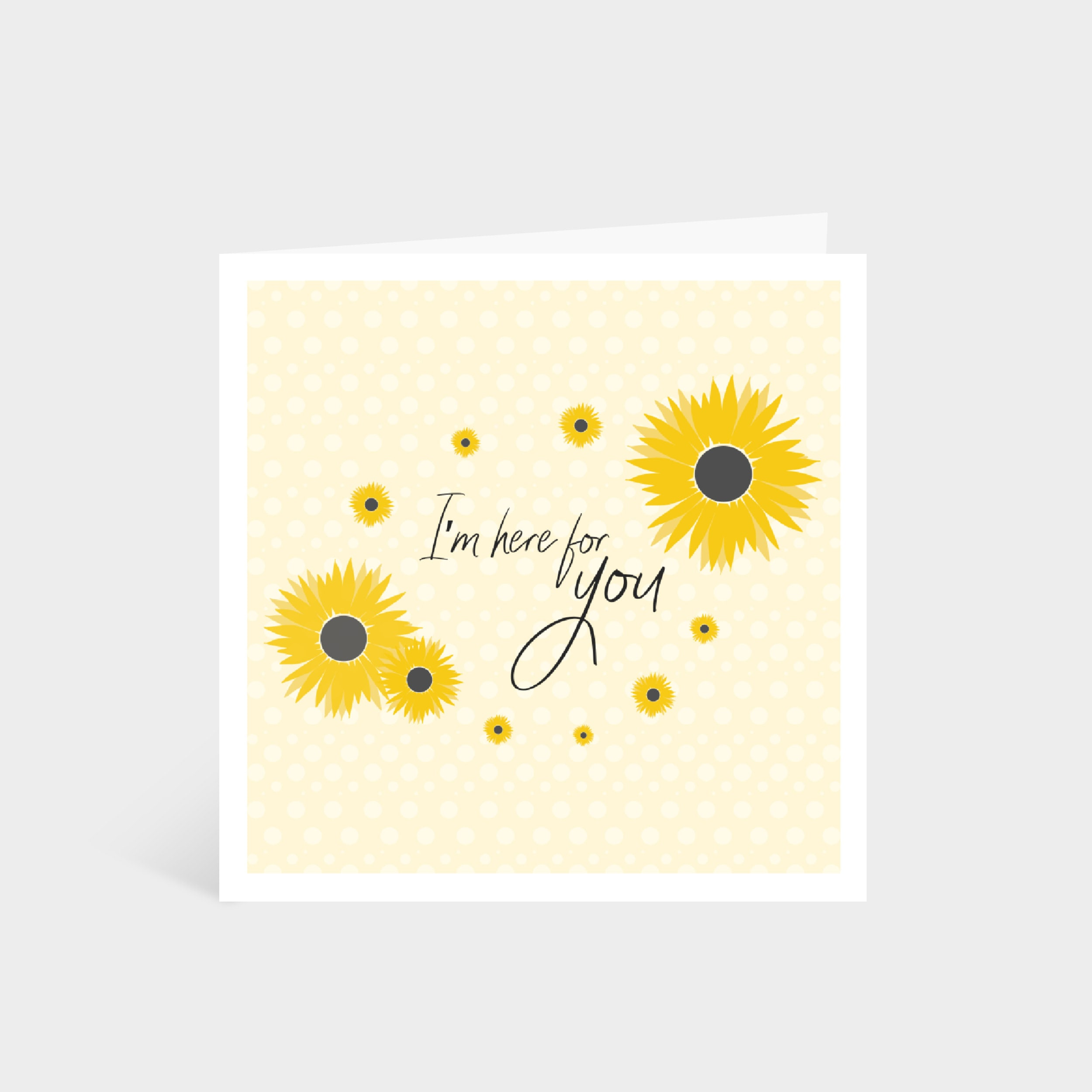 """Standing pale yellow square card with bright yellow illustrated sunflowers; says """"I'm here for you"""" in calligraphy font in the middle"""