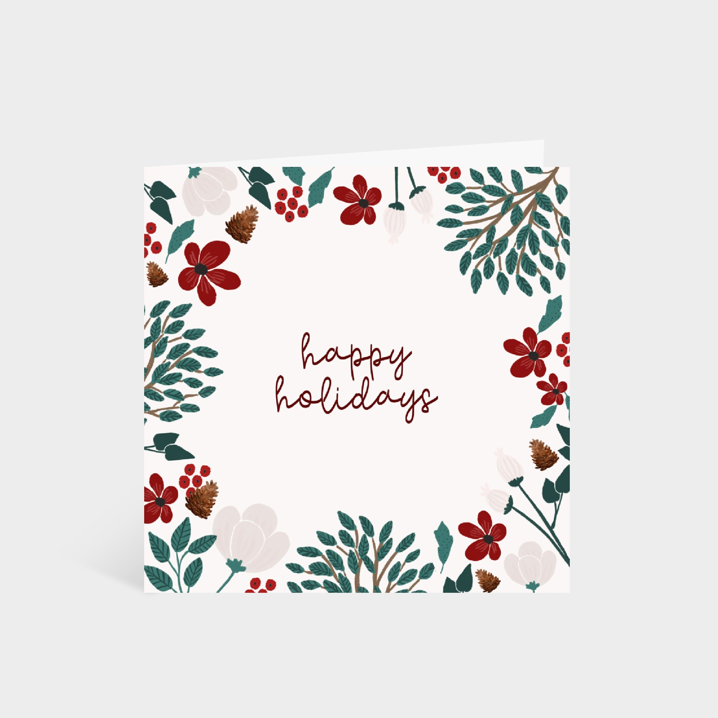 Standing square white card with a border of winter foliage and flowers, and the words 'Happy Holidays' in the centre