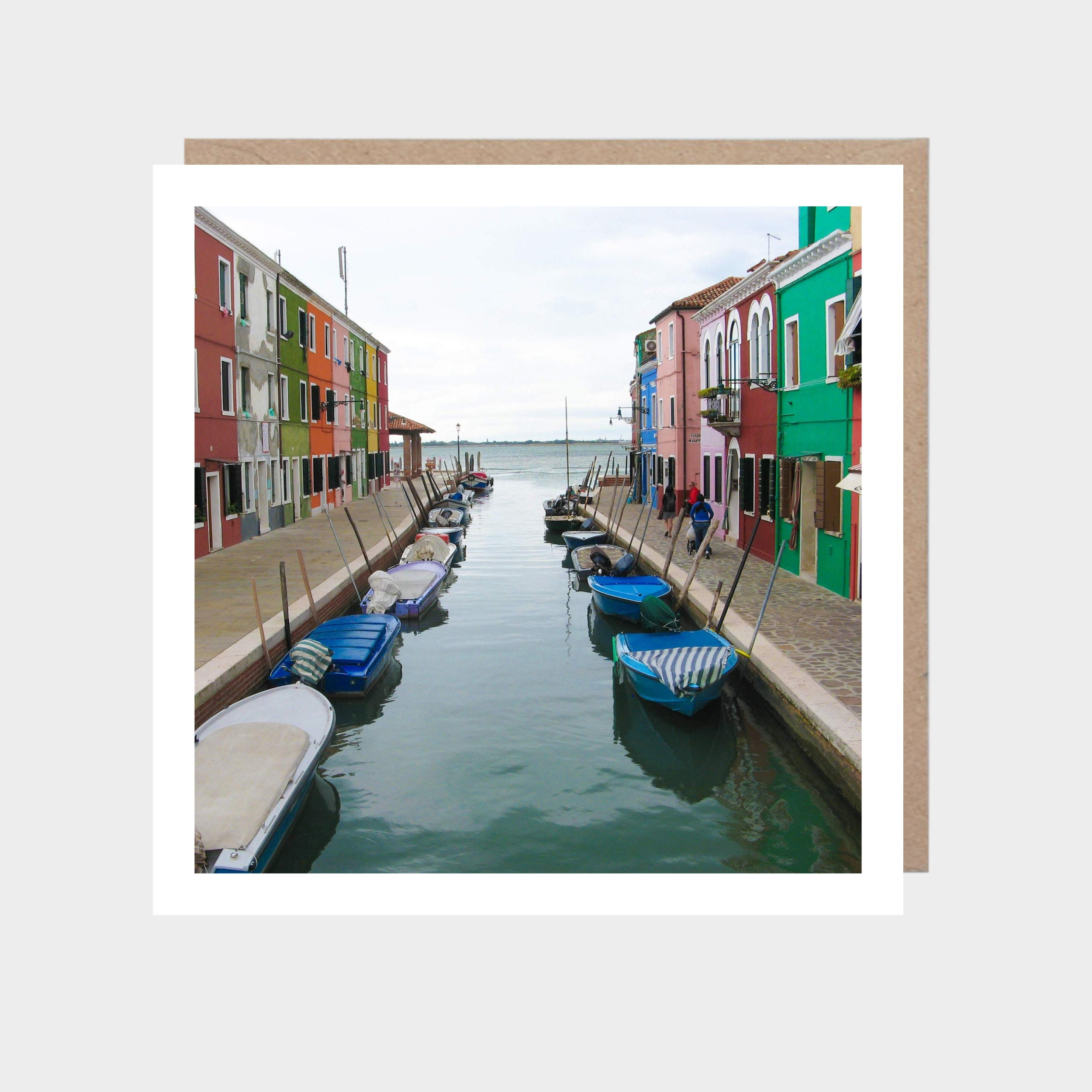 Square card with a photo of Burano, with a brown kraft envelope