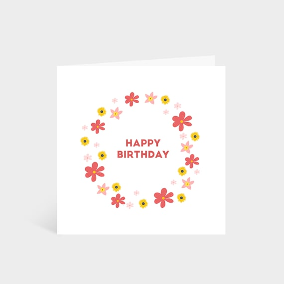Standing square white card with a circle of bright pink and yellow flowers, and the words 'Happy Birthday!' in the centre of the wreath