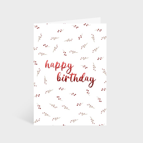 "Standing white card with a red wildflower pattern. Text in the centre of the card says ""Happy Birthday"""