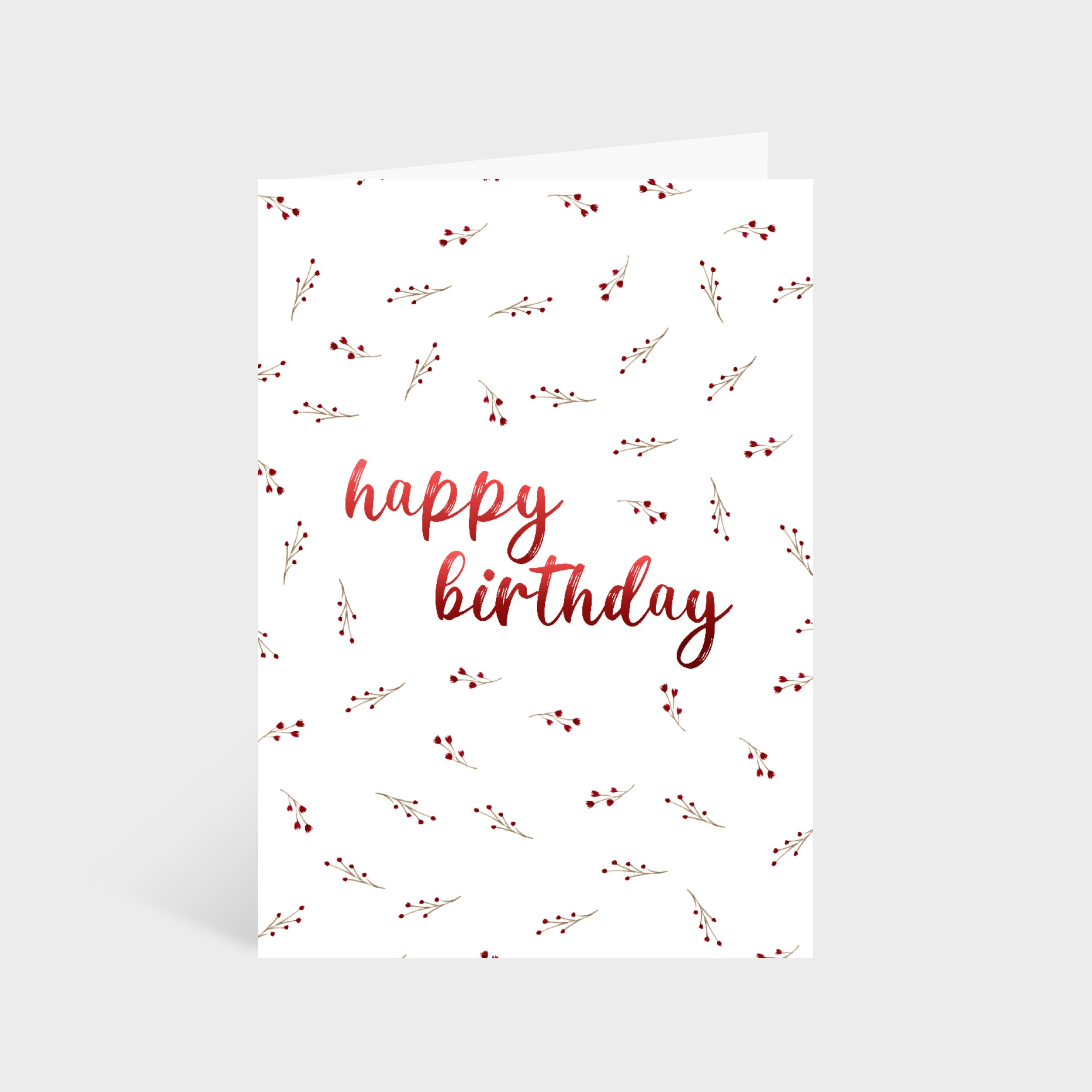 """Standing white card with a red wildflower pattern. Text in the centre of the card says """"Happy Birthday"""""""