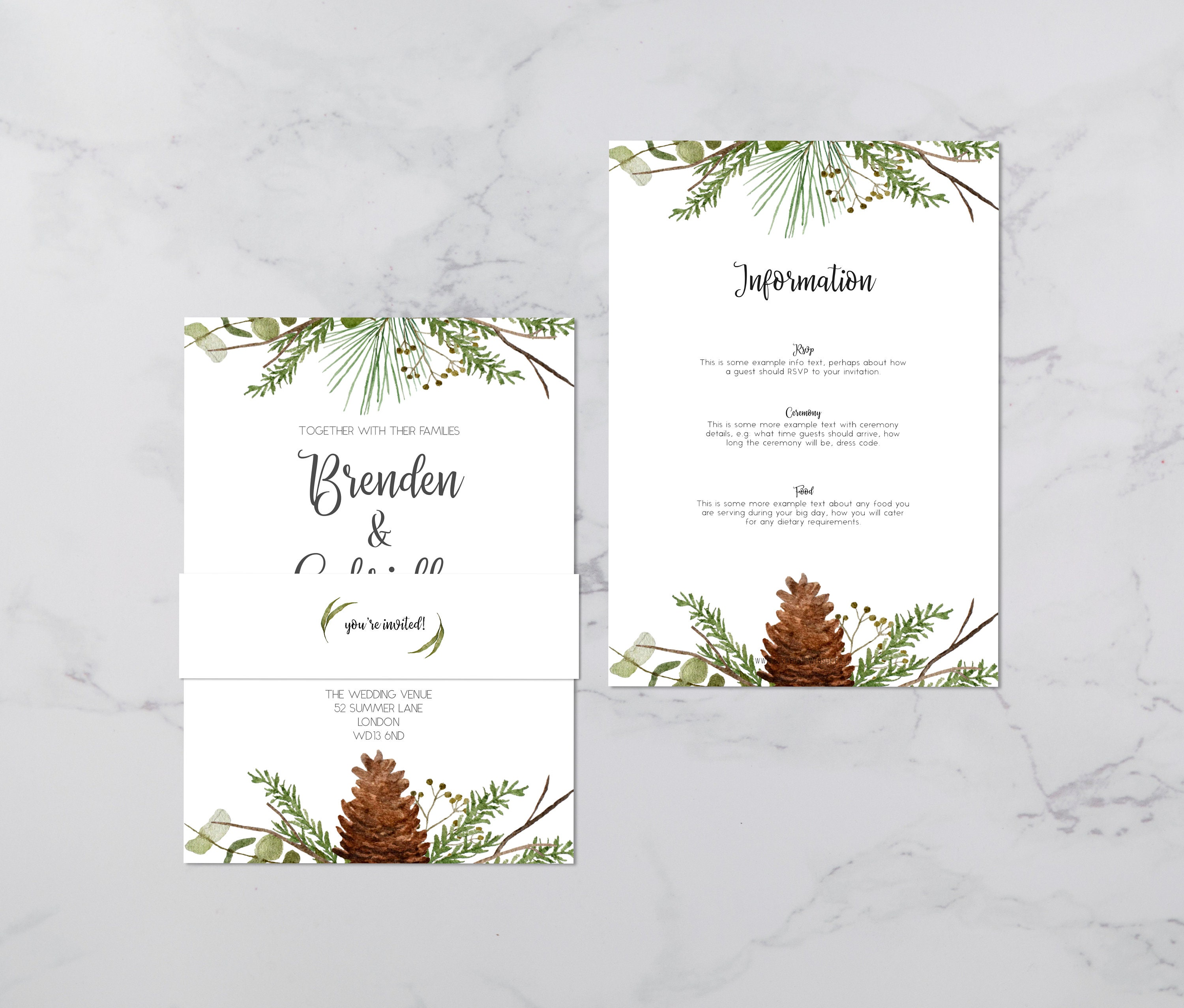 Flat lay photograph of a wedding invitation and information card. The wedding invitation is overlaid with a vellum sheet and wrapped in a belly band. Each card is white, featuring winter foliage illustrations