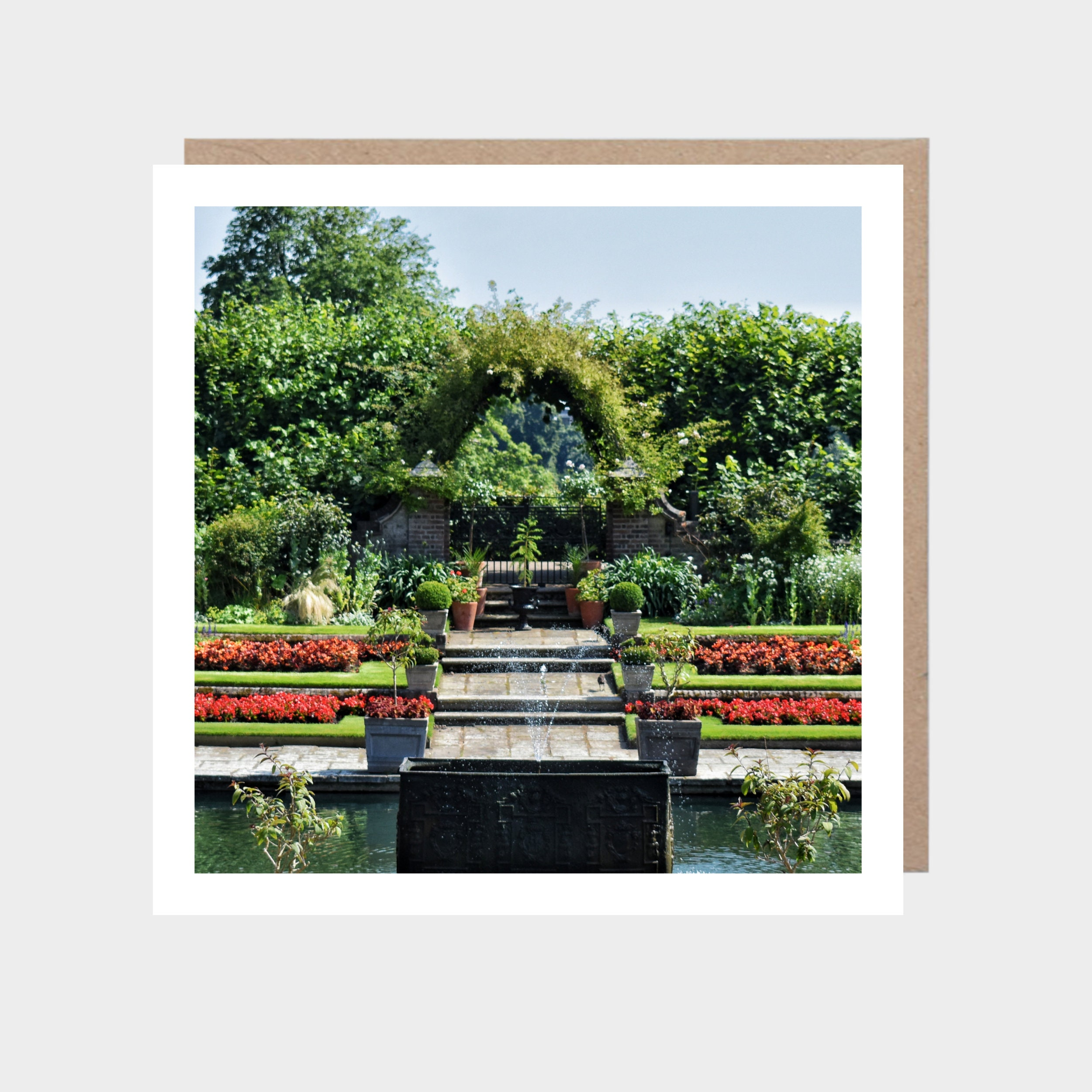 Square card with a photo of Kensington Gardens, with a brown kraft envelope