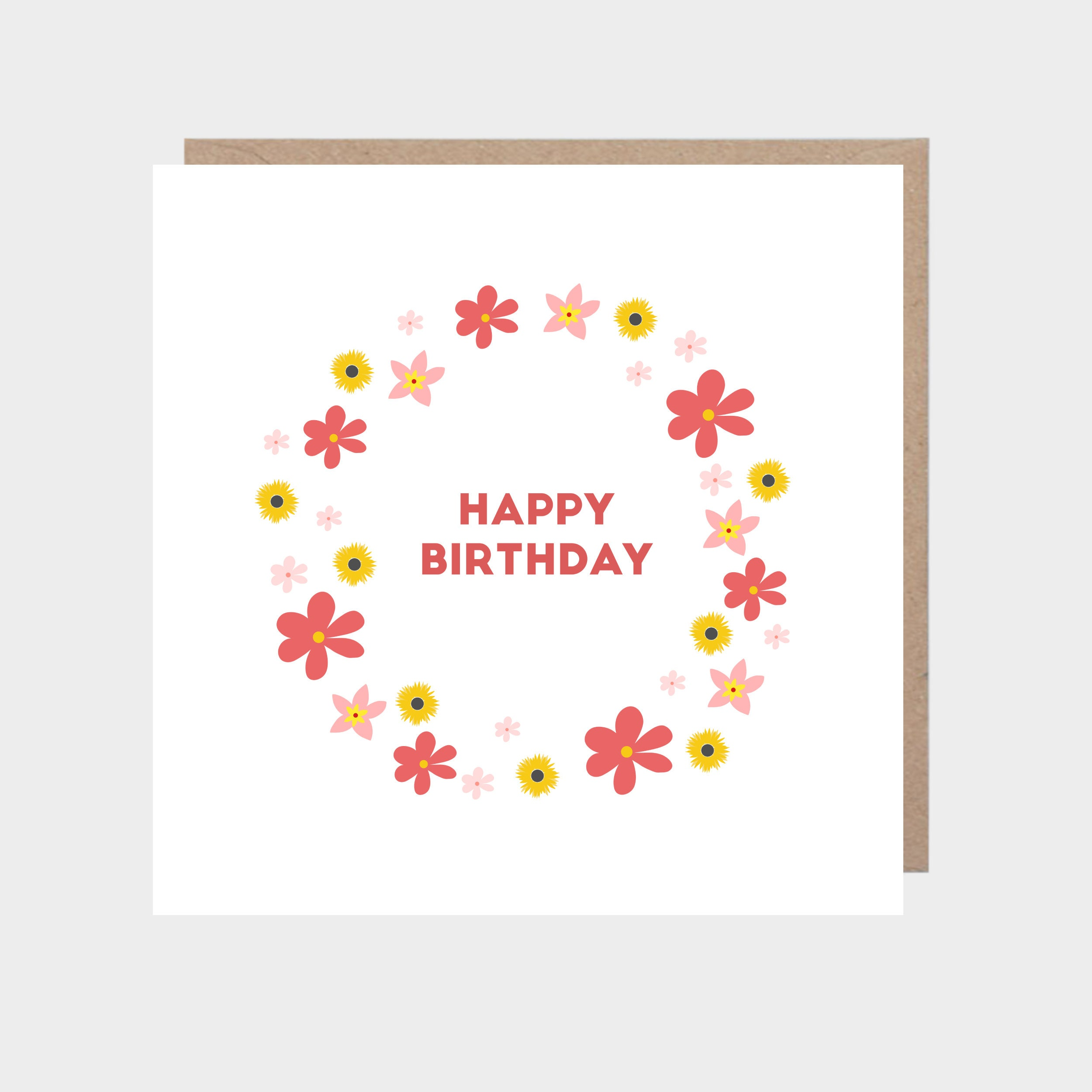Square white card with bold colourful flowers, with a brown kraft envelope