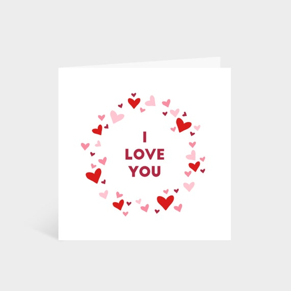 Standing square card with a wreath made out of hearts, and the words 'I Love You' in the middle
