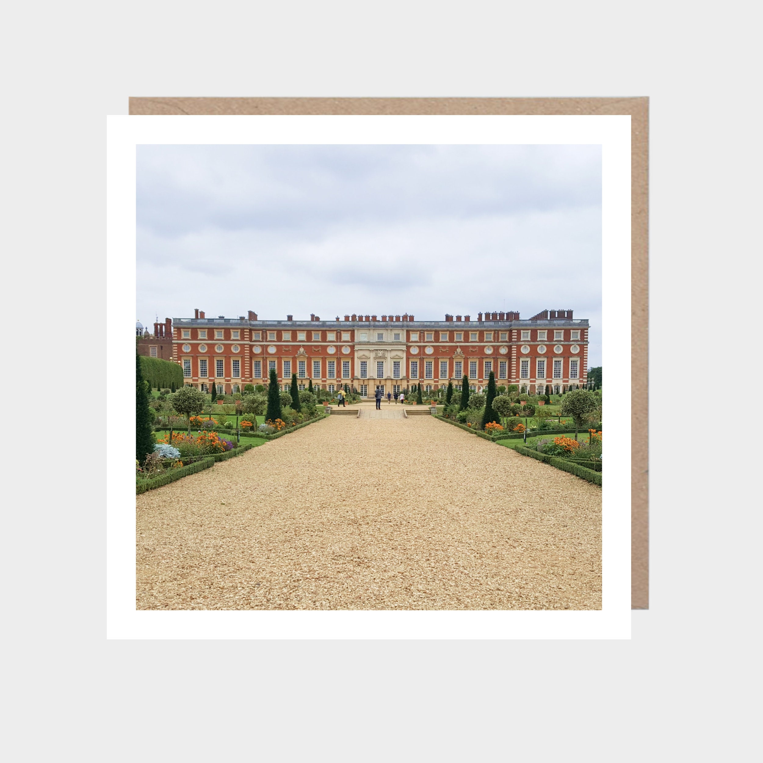 Square card with a photo of Hampton Court Palace, with a brown kraft envelope