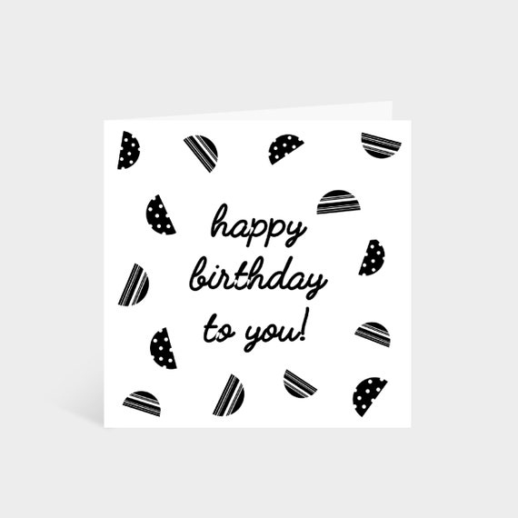 Standing square white card with black patterned semi-circles and the words 'Happy Birthday!' in the middle