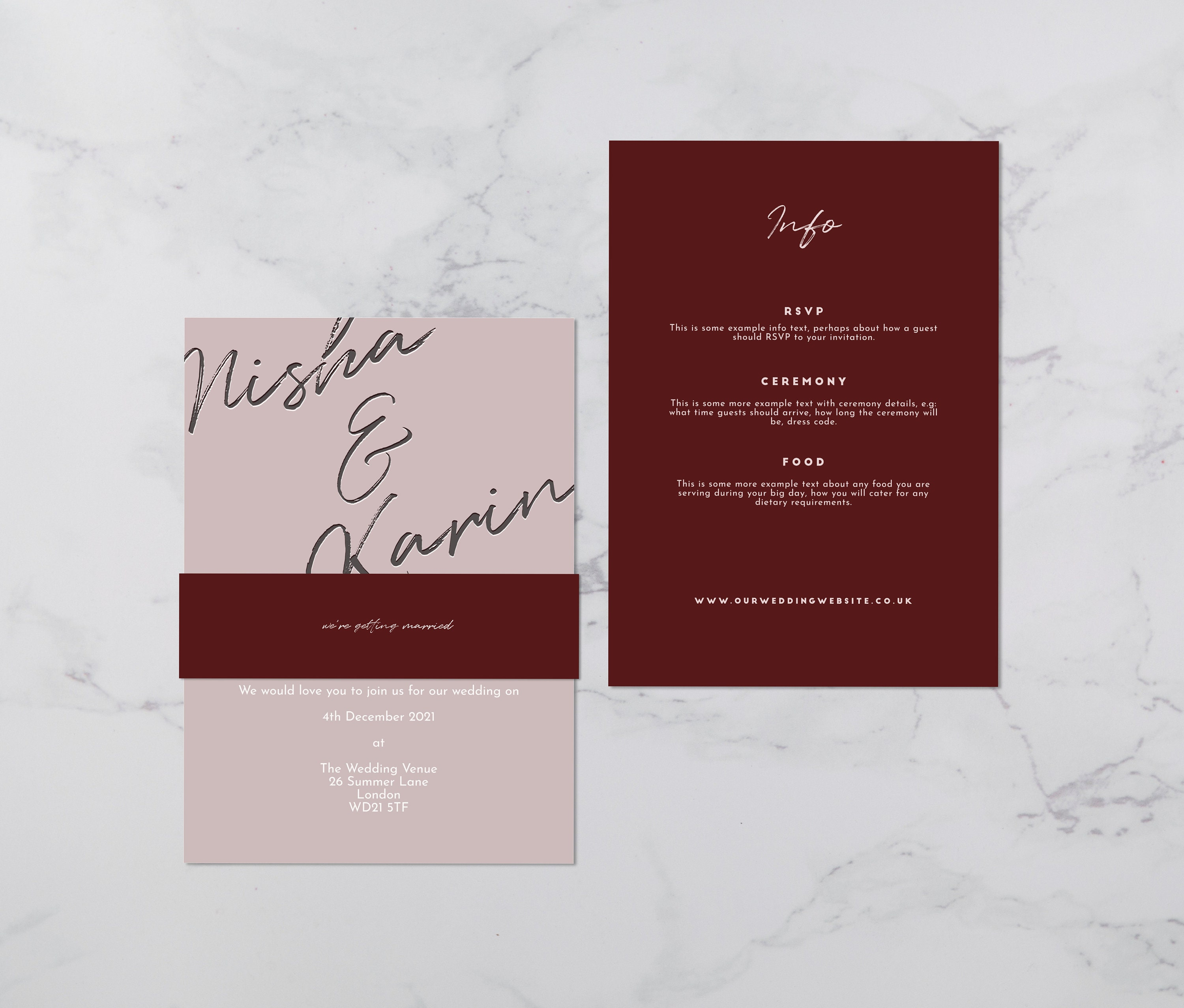 Flat lay photograph of a wedding invitation and information card. The wedding invitation is overlaid with a vellum sheet and wrapped in a belly band. Each card is two-tone burgundy