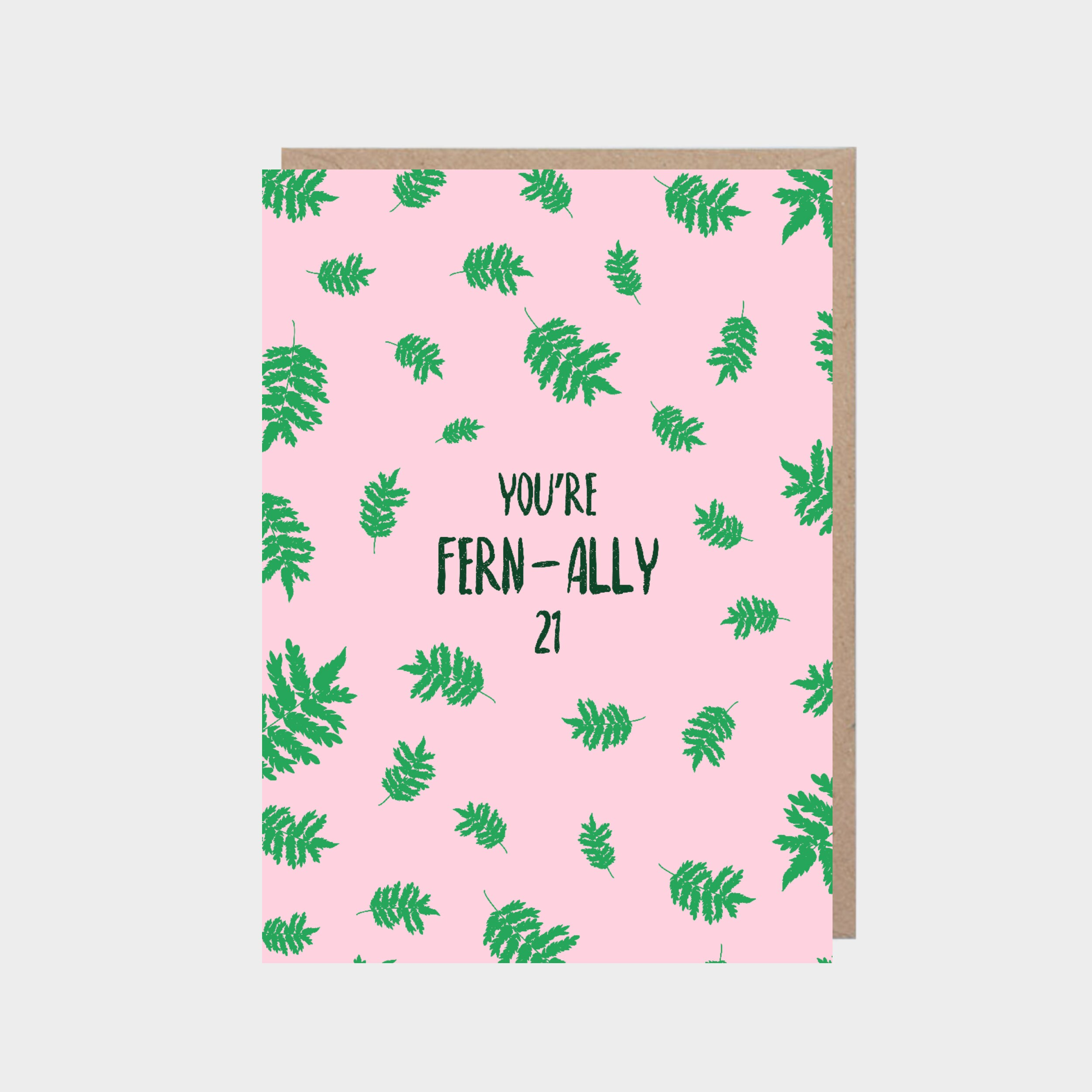 Standing light pink card with illustrated fern leaves, with a brown kraft envelope