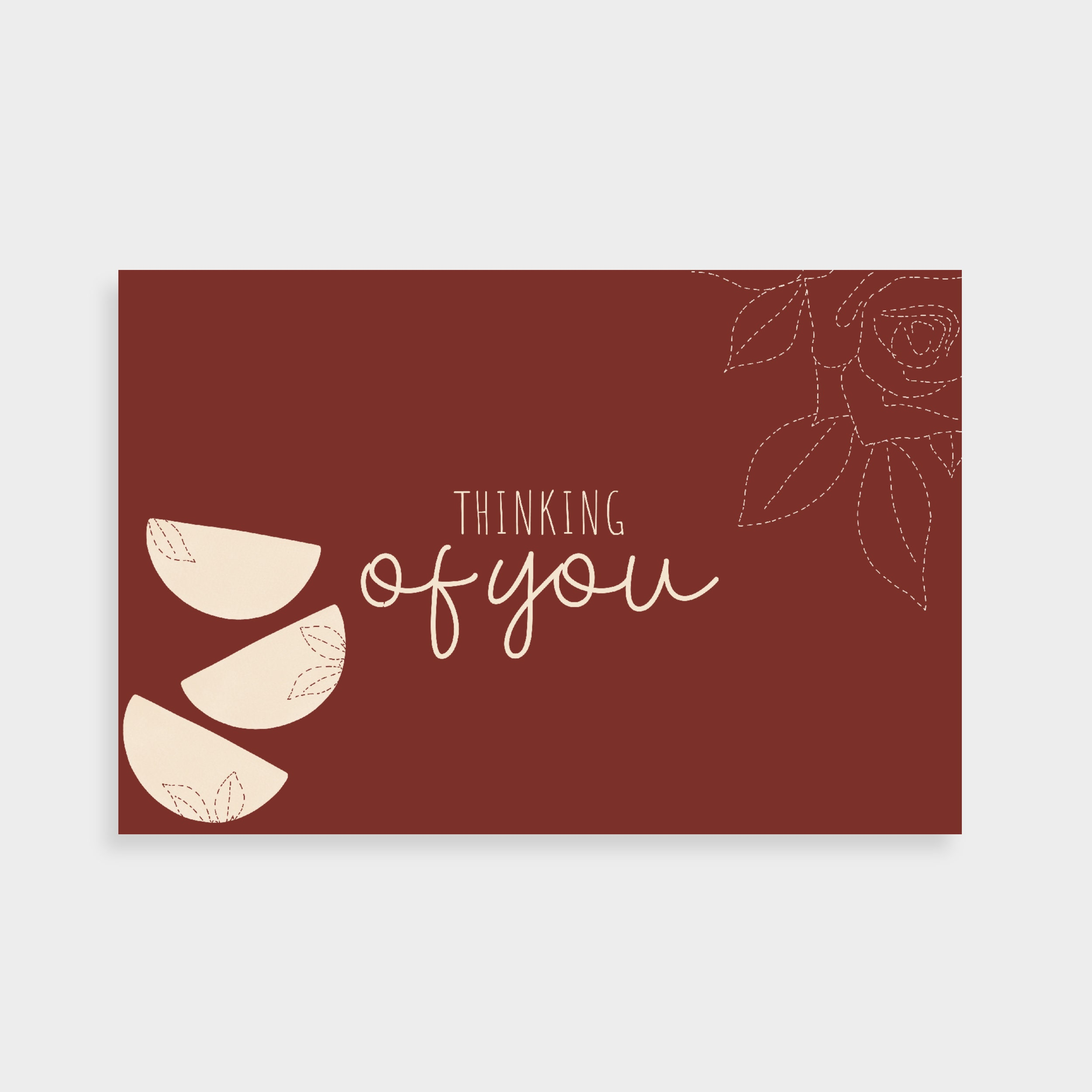 """Dark burgundy postcard with a stack of cream semi-circles stacked on the left with dotted line drawings. Postcard text says """"Thinking of you"""" in the middle."""