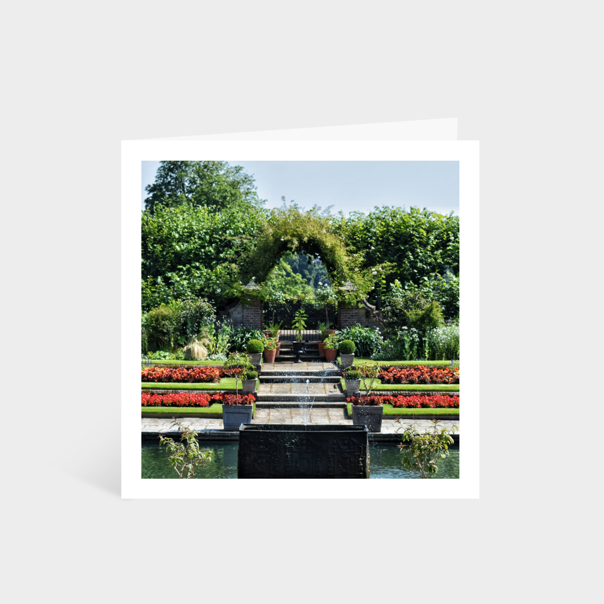 Standing square card with a close up photo of a sunny garden in Kensington Palace