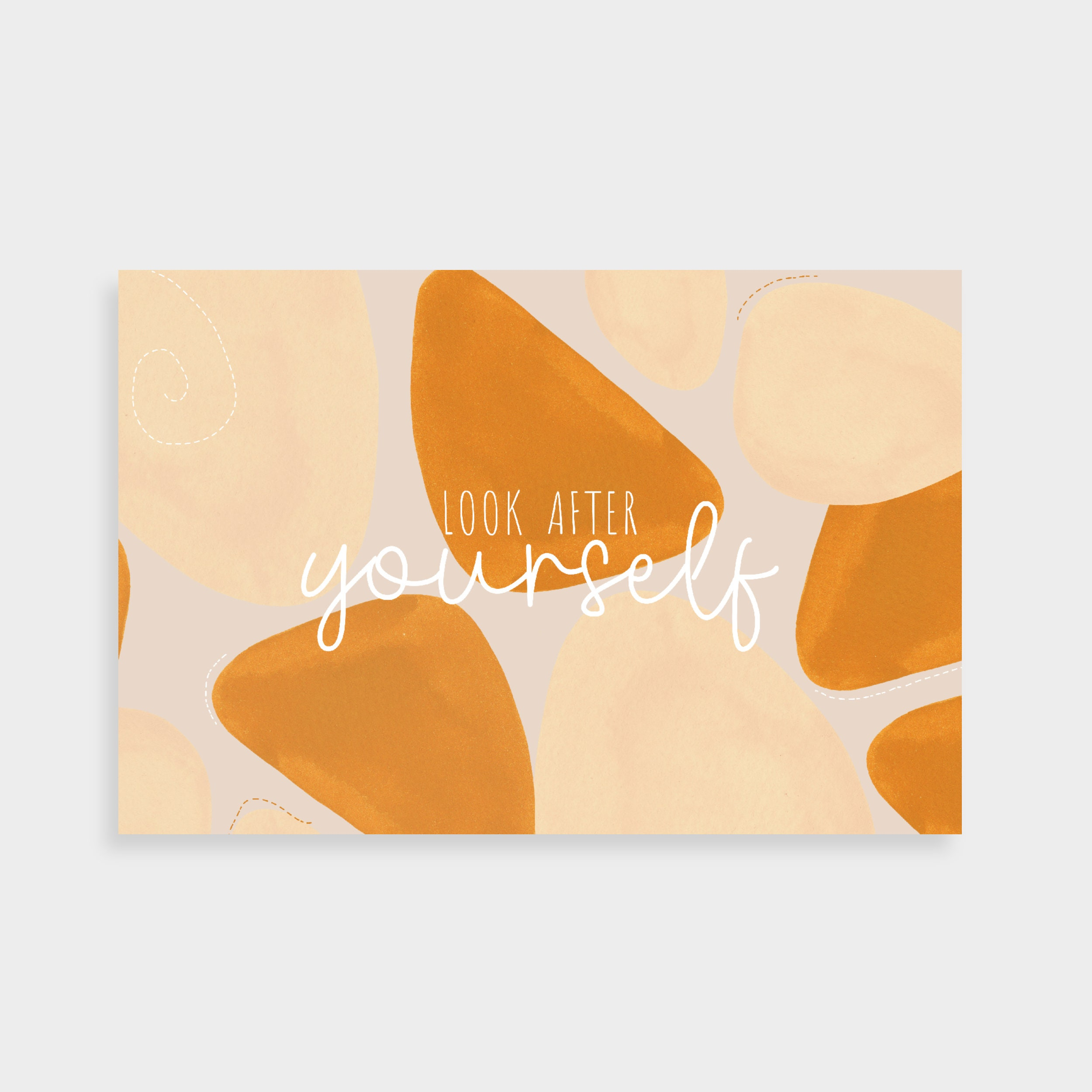 "Cream postcard with orange-y shapes. Postcard says ""Look after yourself"" in the middle."