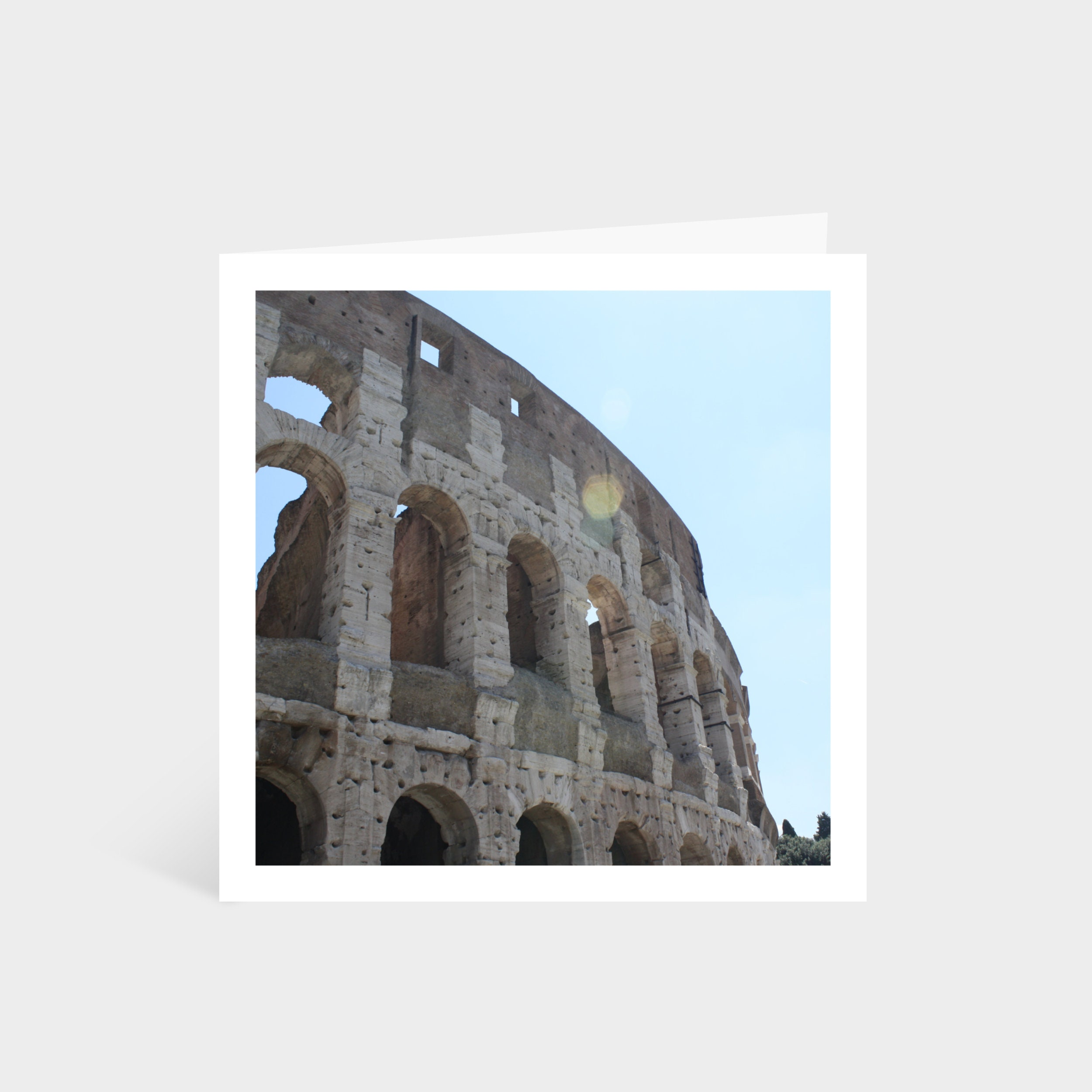 Standing square card with a close-up photo of the colosseum in Rome