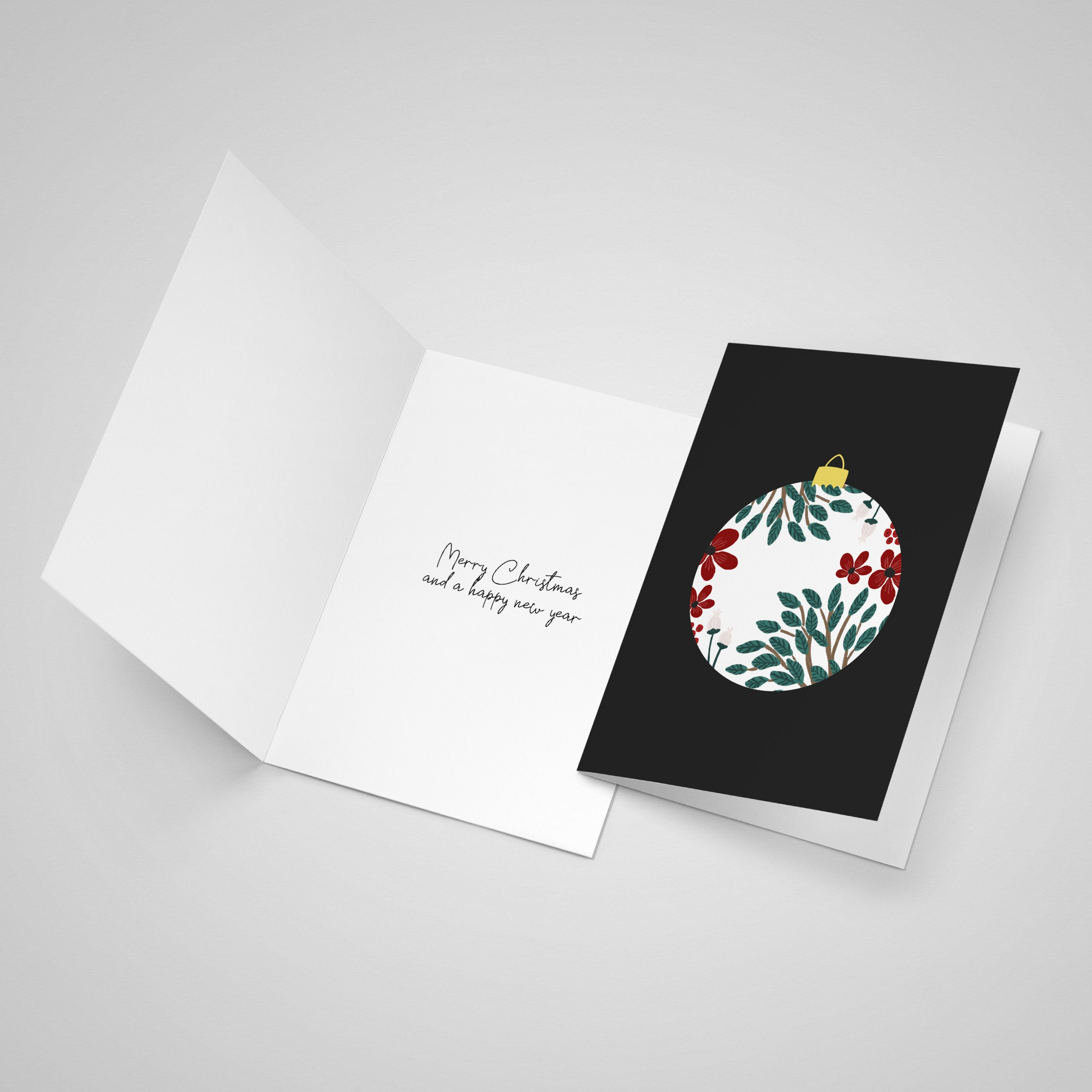 Open card showing that the inside of the card has a festive message printed inside