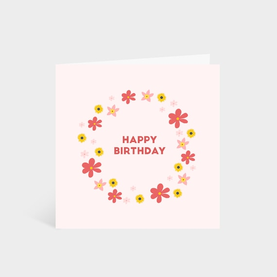 Standing square pink card with a circle of bright pink and yellow flowers, and the words 'Happy Birthday!' in the centre of the wreath