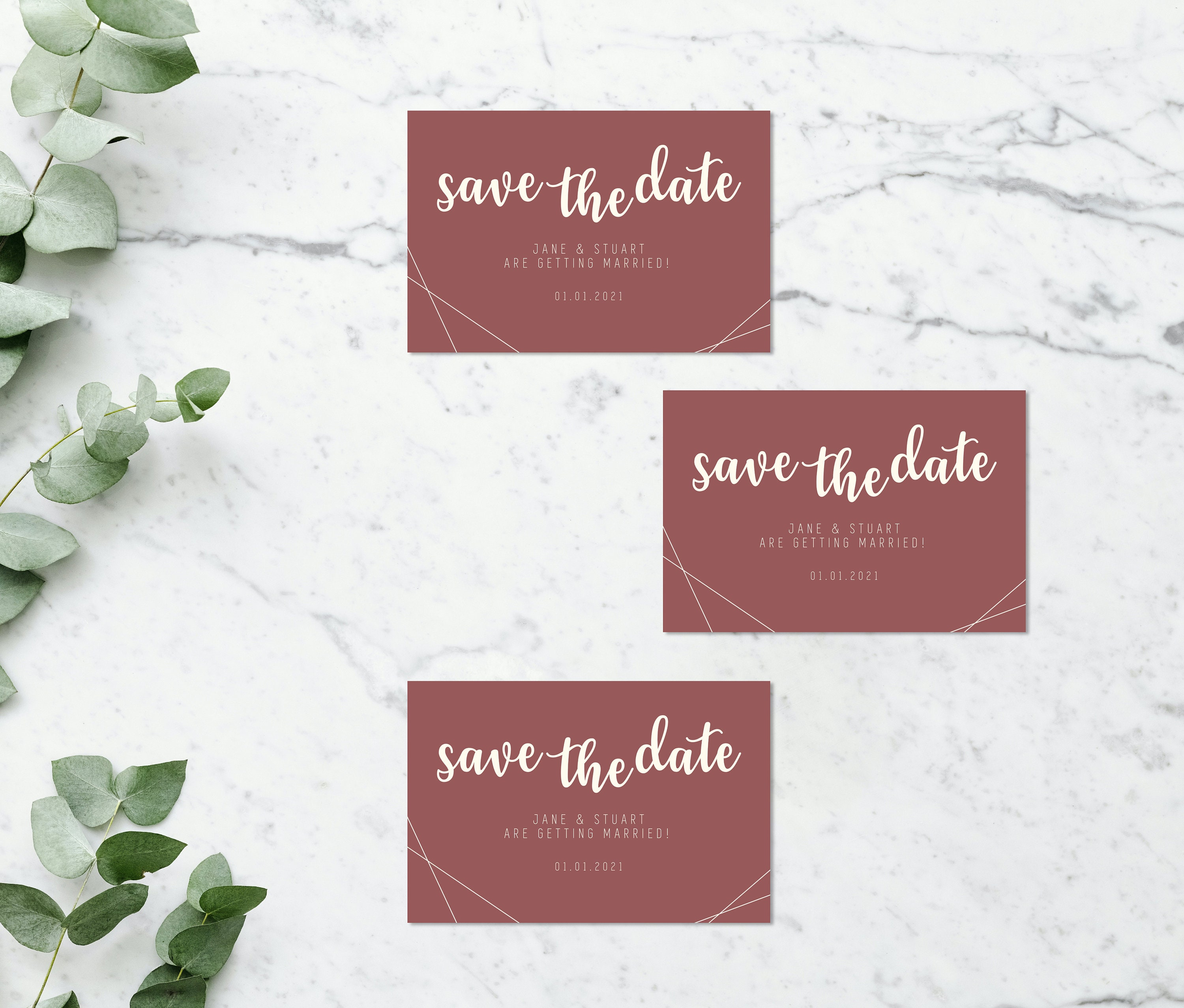 Flat lay photograph of 3 wedding save the date cards and white envelope. The design of each is mostly pink card with cream colour details.