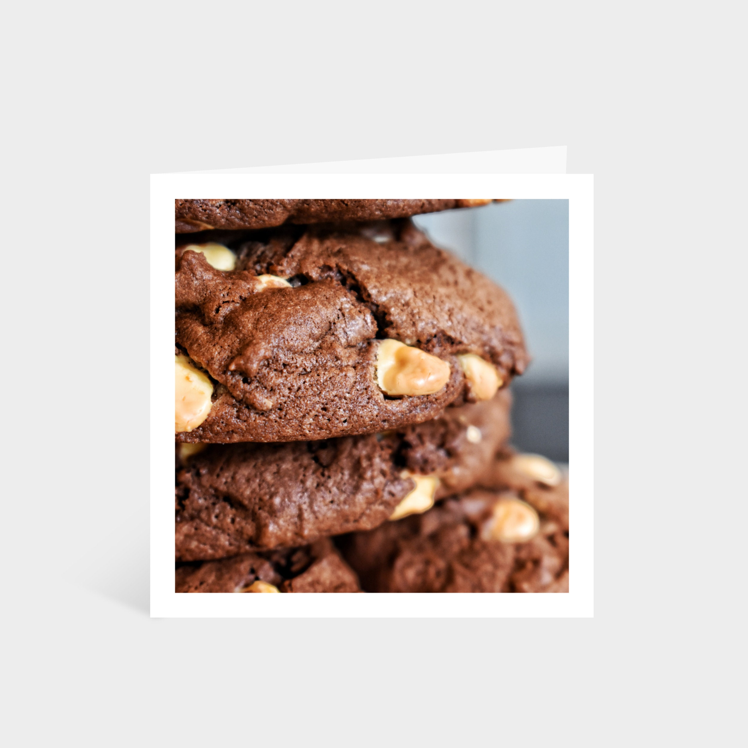 Standing square card with a close-up photo of a stack of double chocolate chip cookies