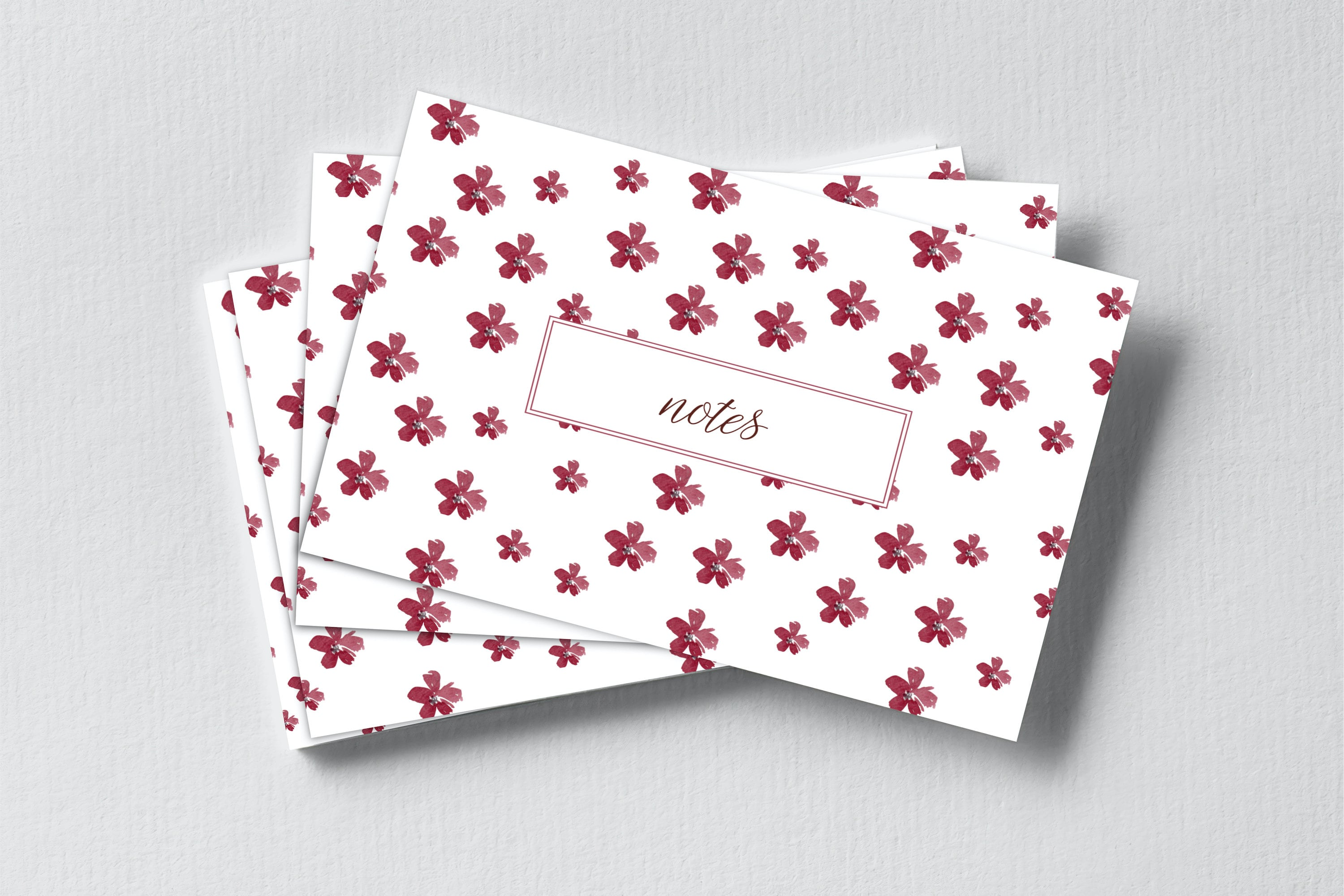 """A stack of white notecards with a pattern of larger red flowers. Each notecard says """"Notes"""" in a red outlined box in the centre"""