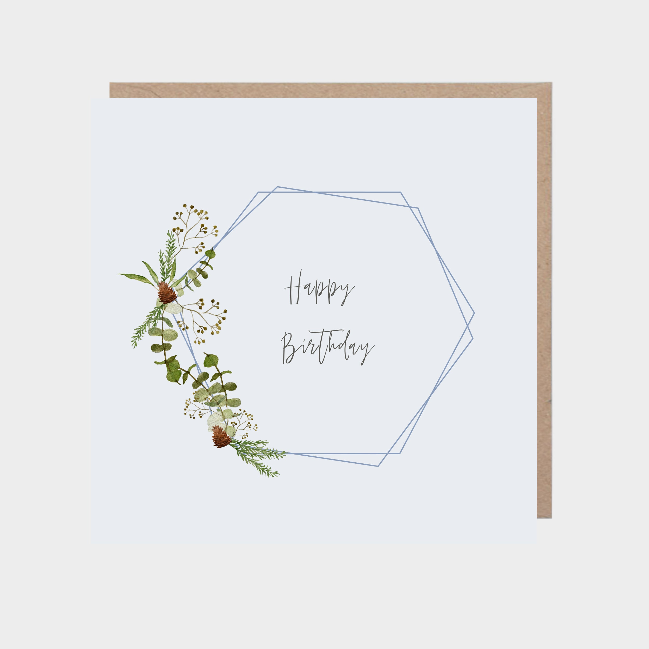 Square light blue card with a geometric winter leaves design, with a brown kraft envelope