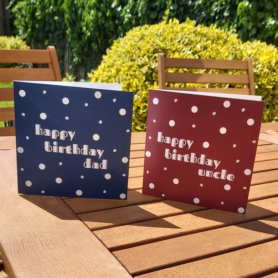 Photograph of blue and red polka dot cards which have been personalised with names on the front.