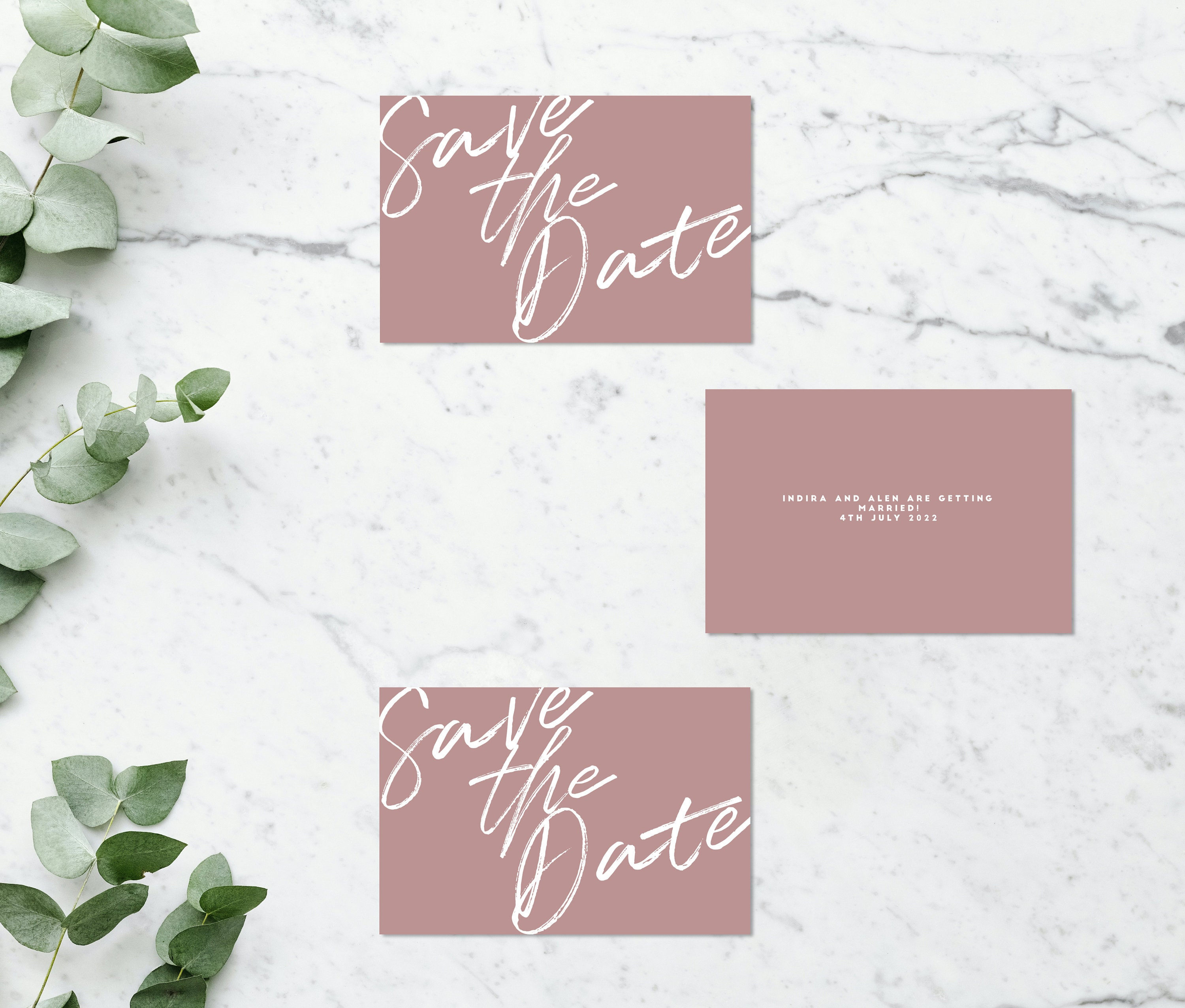 Flat lay photograph showing 3 wedding save the date cards (some front-facing, some showing the reverse). Each card is blush pink.