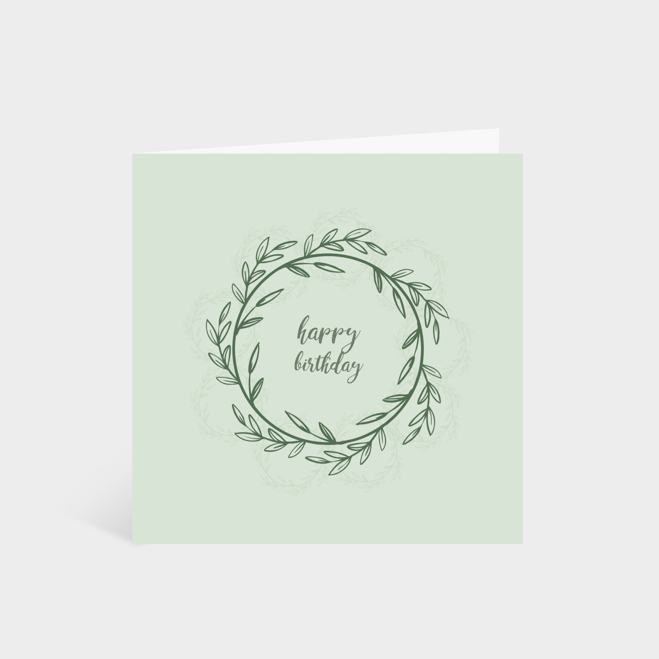 Standing square green card with a floral wreath in the middle, and the words 'Happy Birthday!' in the centre of the wreath