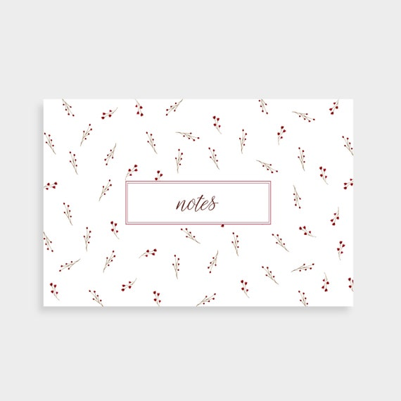 "A white notecard with a pattern of small red floral stems. Notecard says ""Notes"" in a red outlined box in the centre"