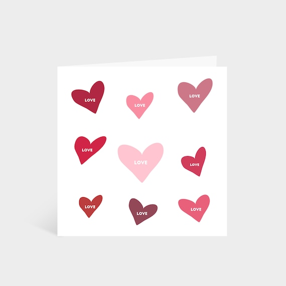 Standing square card with hand-drawn hearts of various pink and red colours, and the words 'Happy Valentine's Day' in the middle