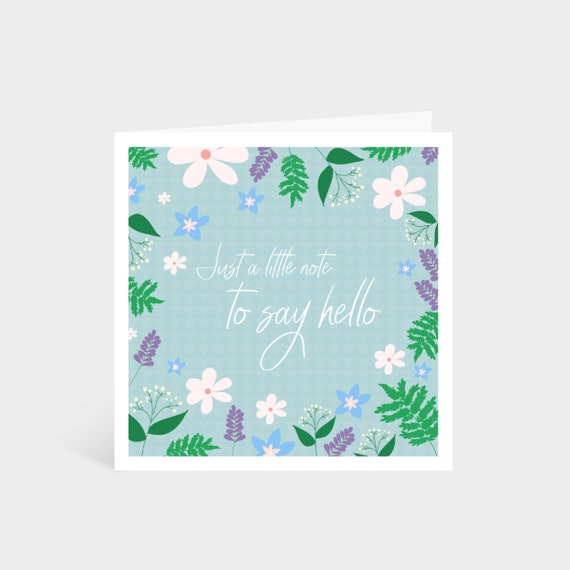 "Standing pale blue square card with a colourful illustrated floral border; says ""Just a little note to say hello"" in calligraphy font in the middle"