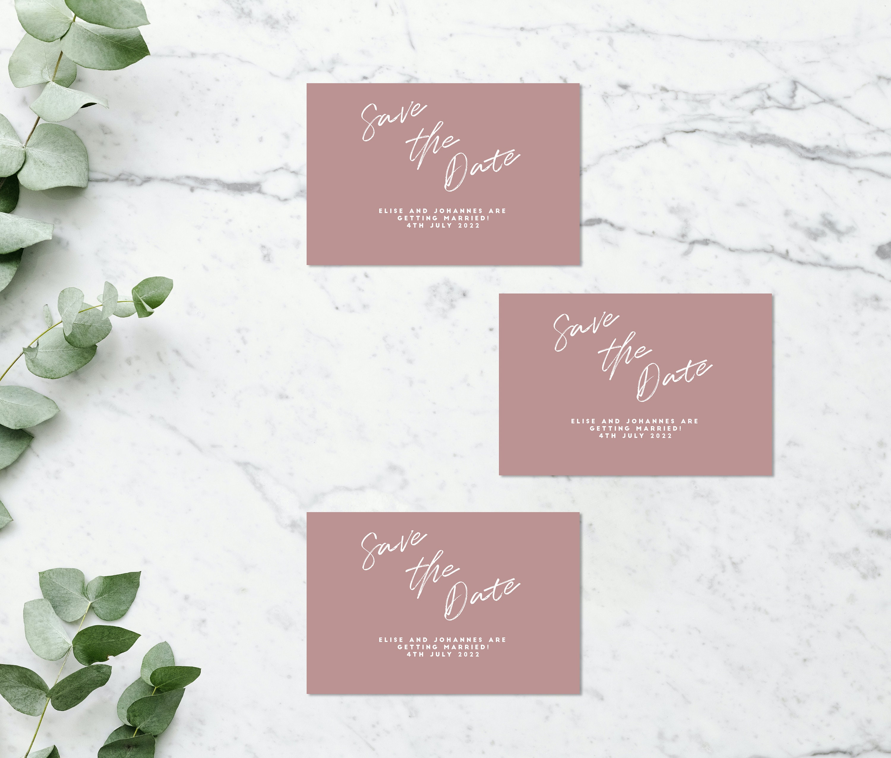 Flat lay photograph of 3 wedding save the date cards and white envelope. Each card is black and white, with headline text sitting between the two - both white and black.