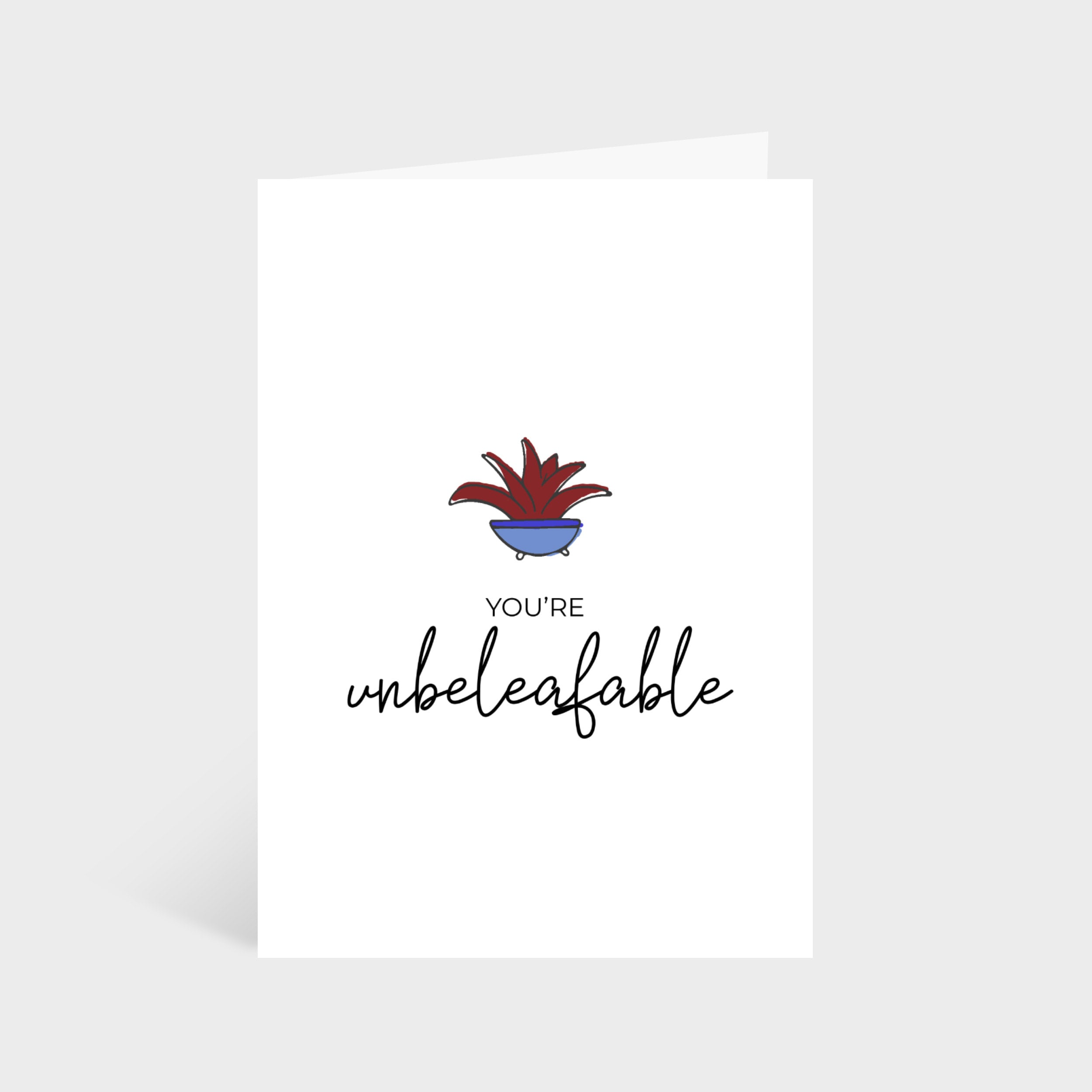 """Standing white card with an illustrated leafy plant. Text underneath says """"You're unbeleafable""""."""