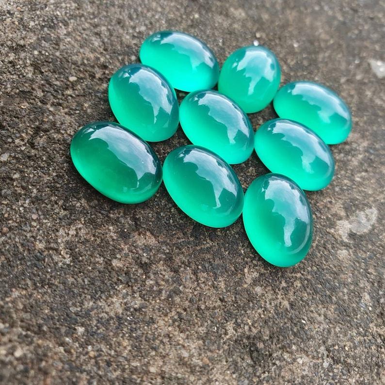 emerald like calibrated flat back oval gemstone Green onyx cabochon custom sizes are available. all calibrated sizes available