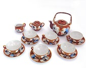 Japanese Satsuma egg porcelain tea set, teapot and four cups and saucers. 1930-40 Mid-century.