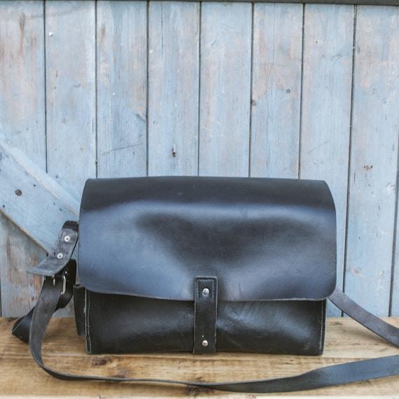 Old, black leather mail bag