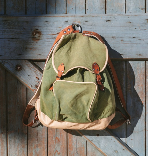 Old hiking backpack green
