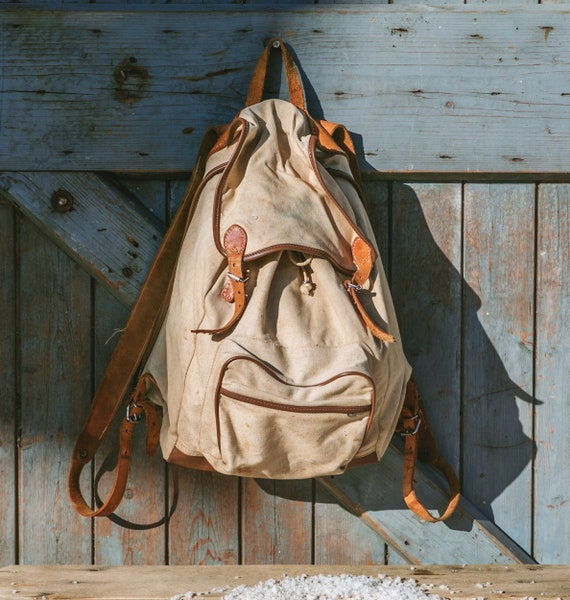 Old hiking backpack beige