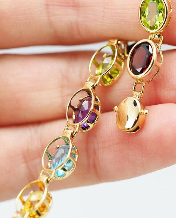 Yellow Gold Bracelet . 17 Assorted Gemstones . Gol