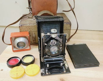 Antique German Reform Clack 1930s Camera With Leather Bag, Extra Lenses, and Metal Box for Camera and Accessories