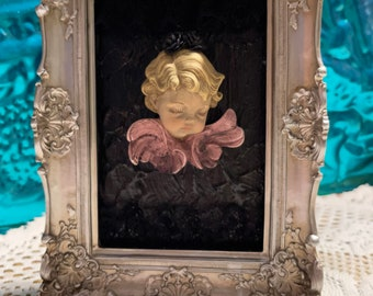 vintage upcycled cherub ornament with lace in ornate plastic frame