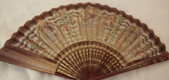 Antique hand fan hand painted. Detailed with gold