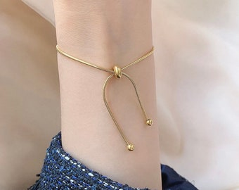 Tied together with a Bow bracelet