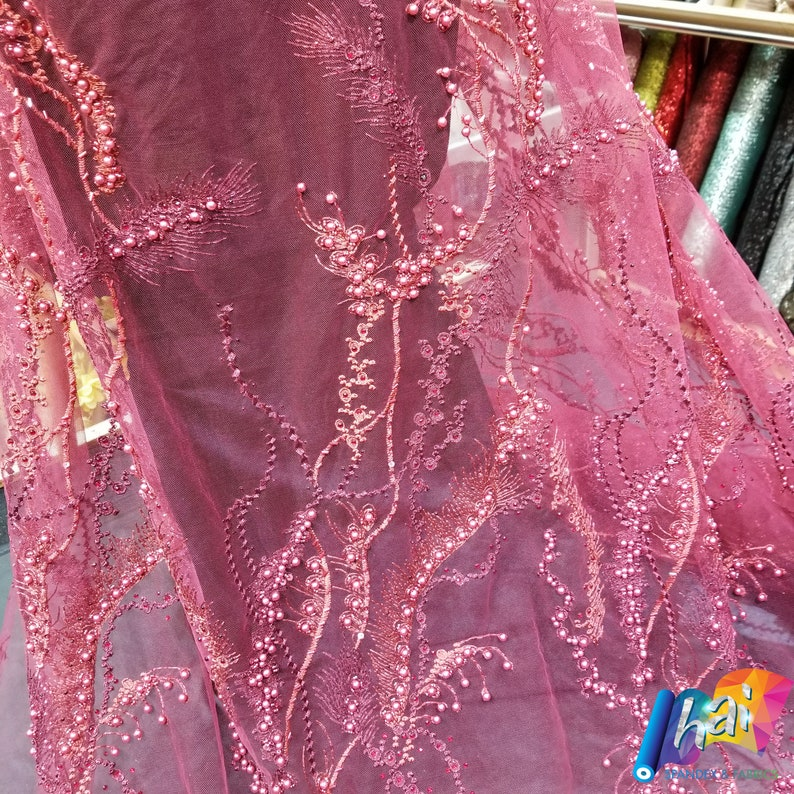 Burgundy Elegant Embroidery lace Shimmering Pearls Beads Sequin on stylish one way pattern over a Mesh Fabric Haute Couture Fabric