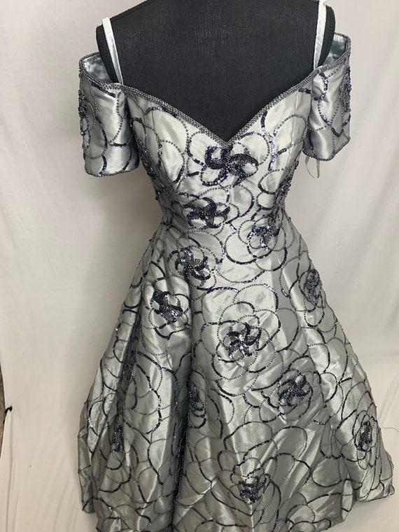 Full grey breaded ball gown
