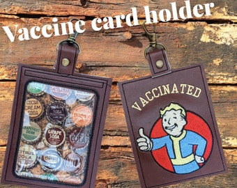 Wasteland kid vaccination card protector. Attach to purse, bag, backback or beltloops Vinyl, cork, leather.