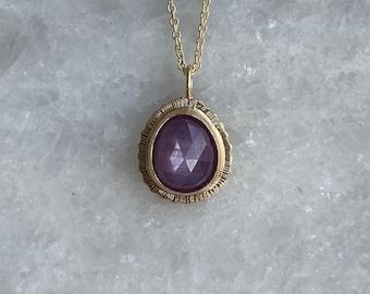 Rose cut Pink/Purple Star Sapphire pendant in 9ct gold