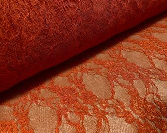 Floral stretch lace net fabric, per metre - burnt orange