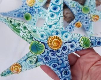 3 x textured ceramic starfish art wall hangings. Coastal theme room decor. Gift for seaside lover. Beach sea creatures bathroom wall idea.