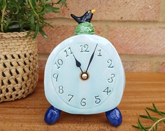Mantelpiece bedside table clock. Handmade quirky ceramic with blackbird design. Blue and indigo, organic pebble shaped. Country home.